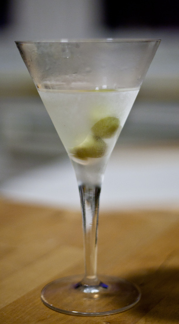 Frosty martini glass with two olives